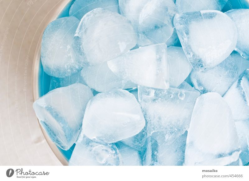close up of ice cubes in a blue bowl - studio shot from above Bowl Lifestyle Kitchen Restaurant Water Freeze Cool (slang) Bright Clean Blue White Purity