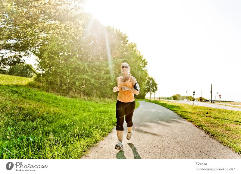 running Lifestyle Healthy Leisure and hobbies Summer Sun Sports Jogging Feminine Young woman Youth (Young adults) 18 - 30 years Adults Environment Nature