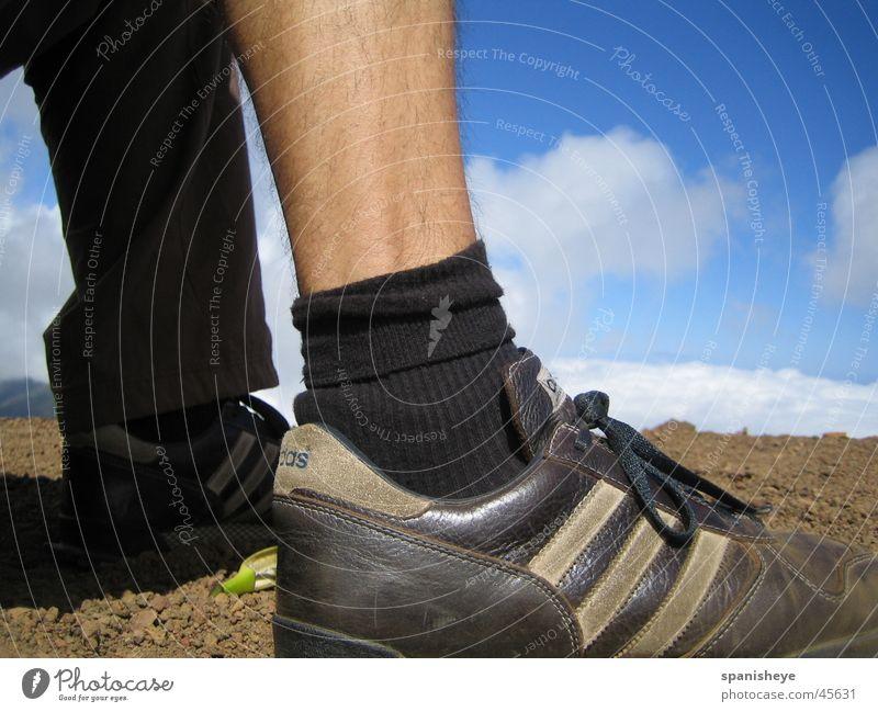 Human being Sky Blue Calm Sports Footwear Legs Graffiti Brown Masculine Walking Near Leisure and hobbies