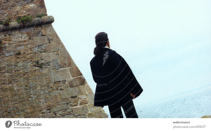 Man looking at the sea Sky Ocean Wall (barrier) Coat Long-haired Light blue back lon hair