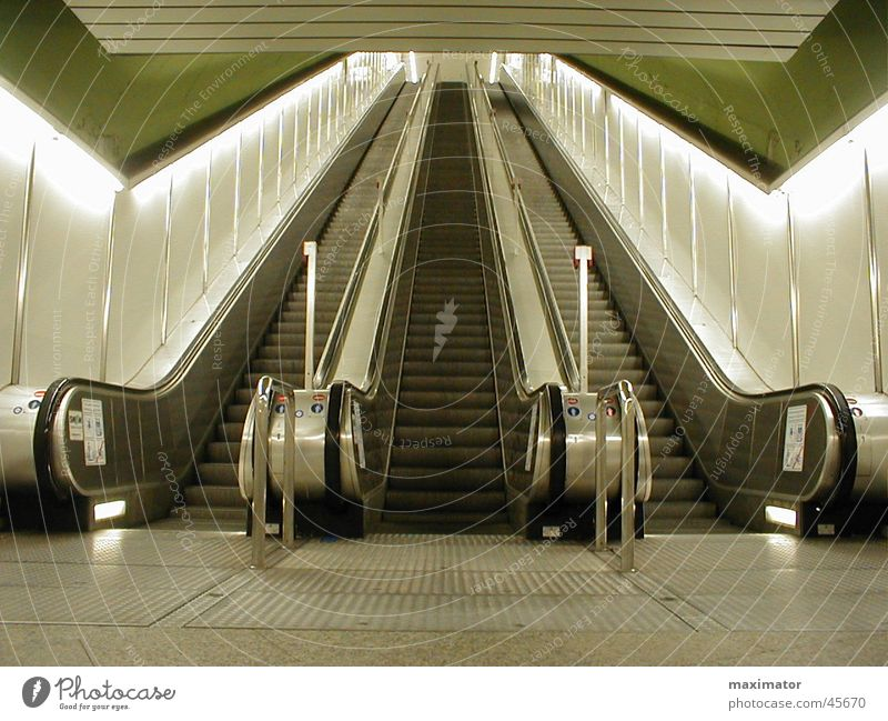escalator Escalator Arrival Underground Commuter trains Movement Electrical equipment Technology Stairs Warehouse Train station Metal Logistics Upward Downward