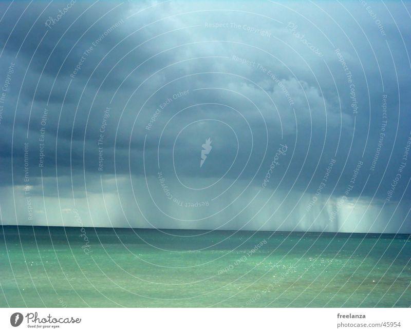rain Beach Ocean Vacation & Travel Clouds Sun Water Rain Blue