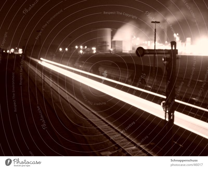 "Regional train in front of ""sugar beet factory skyline"" Long exposure Dark Speed Railroad tracks Industrial Photography Bright Smoke"
