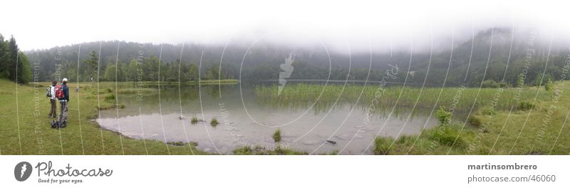 Lake in the fog Fog Hiking Man Woman Grass Body of water Green Mountain Nature Landscape