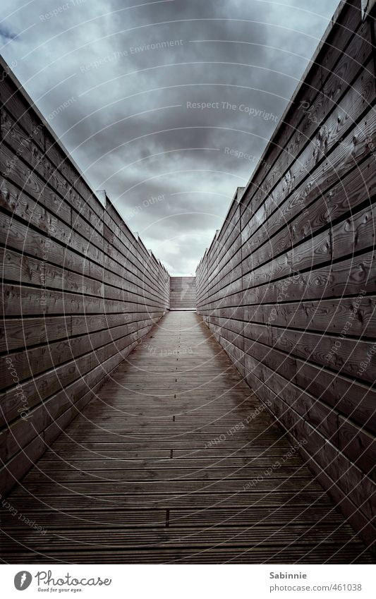 Wall, there's a light at the end of the tunnel. Sky Clouds Bad weather Manmade structures Architecture Wall (barrier) Wall (building) Roof Gloomy Distress