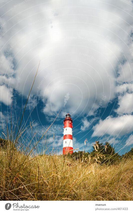 shining tower Nature Landscape Clouds North Sea Island Lighthouse Manmade structures Tourist Attraction Vacation & Travel Colour photo Exterior shot Deserted