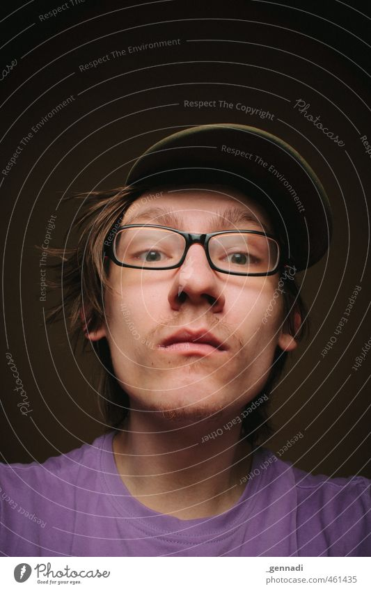 What do I see? Young man Youth (Young adults) Face 18 - 30 years Adults T-shirt Eyeglasses Cap Looking into the camera Worm's-eye view Violet Eating Funny