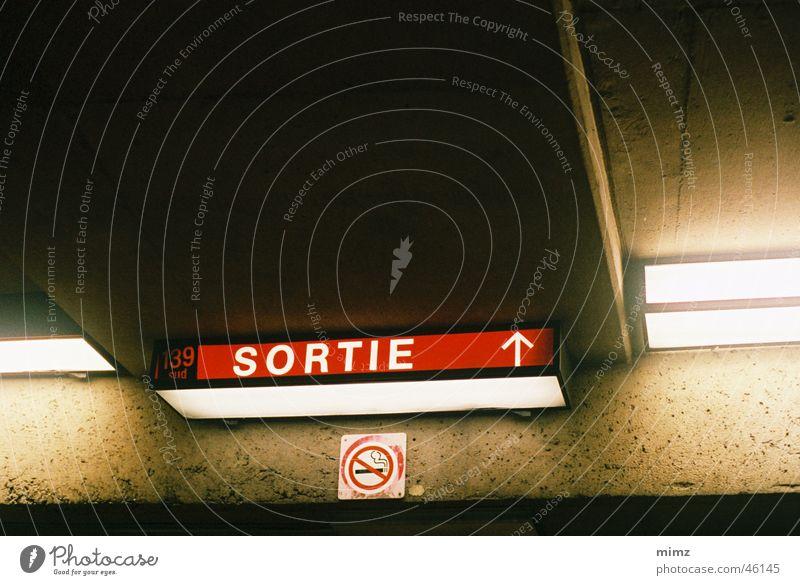 exit sign Underground Montreal ligt concrete dark Town
