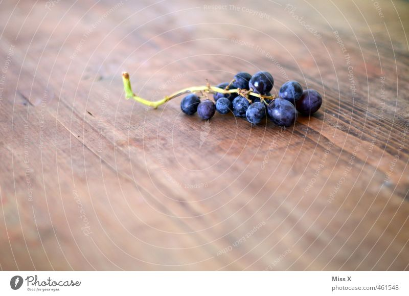 grapes Food Fruit Nutrition Organic produce Vegetarian diet Fresh Healthy Juicy Sour Sweet Blue Violet Bunch of grapes Vine Wooden table Colour photo