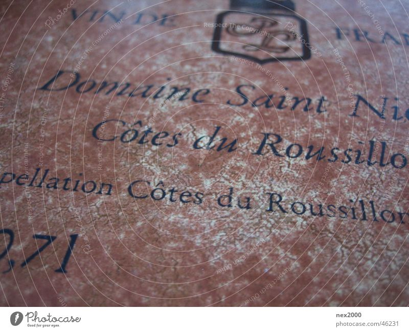 Characters Wine Typography Ancient Label Text Section of image Partially visible French Latin script Roussillon