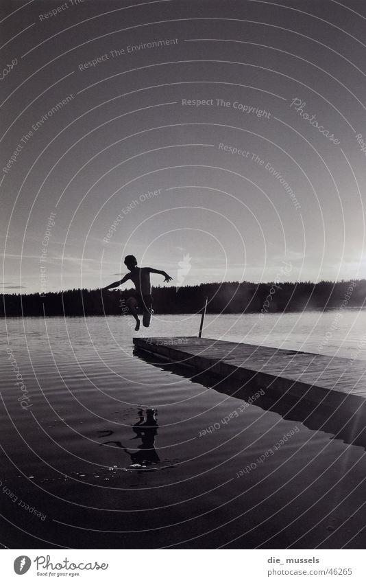 jump into the wet Lake Jump Footbridge Water Black & white photo Sweden