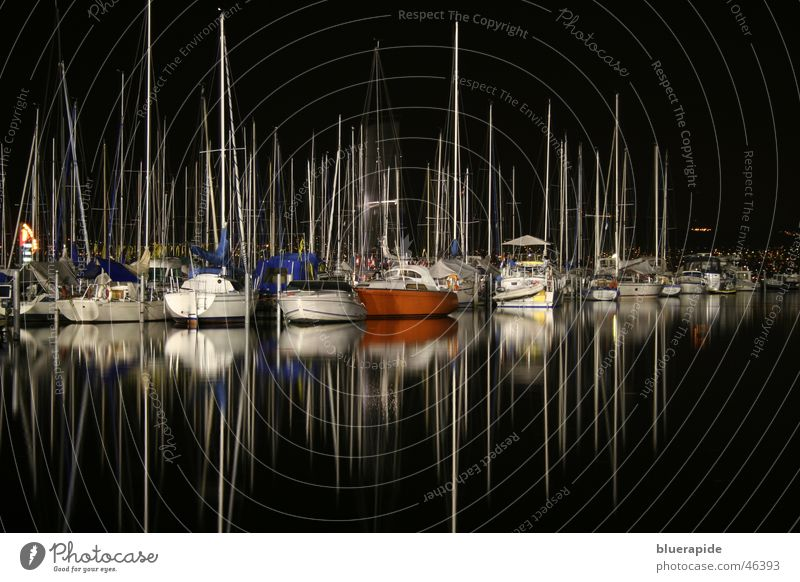 Water Black Loneliness Calm Dark Lake Watercraft Harbour Mast Sailing ship Night shot Water reflection