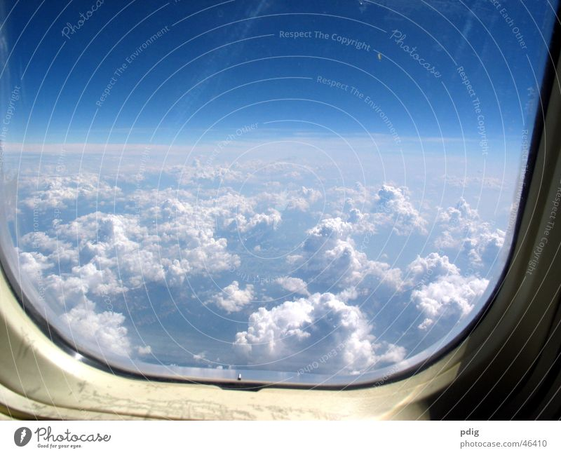 above the clouds Vacation & Travel Aviation Air Clouds Window Airplane Glass Flying Tall Cold Level Aerial photograph
