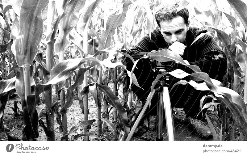 The Photographer Man Crouch Field Black White Tripod Hand Pants Jacket Grief Think zdenek Sit Black & white photo Maize Camera milolta conica
