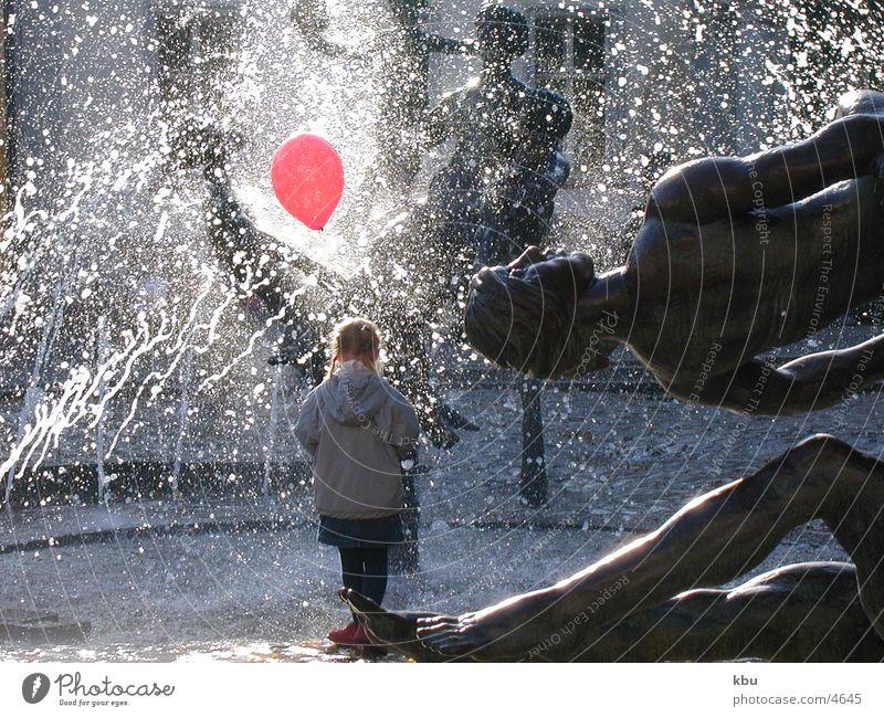 redBalloon Snapshot Human being Fountain of Friendship in Rostock