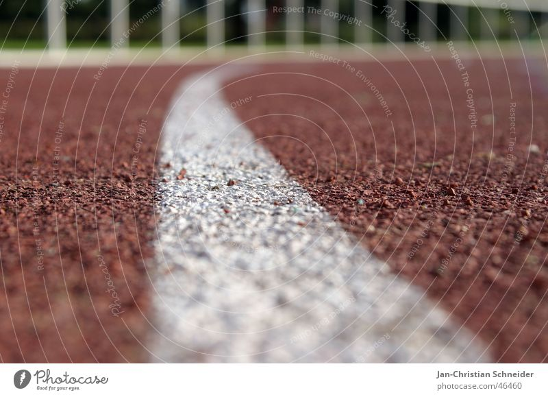 Raceway 3 Red Stripe White Sun Light Subsoil Sporting event Resume Sportsperson Walking Shadow Floor covering Row Railroad Line