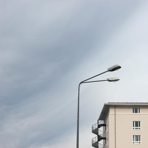 big brother Energy industry Street lighting Sky Clouds Rostock House (Residential Structure) Manmade structures Building Wall (barrier) Wall (building) Facade