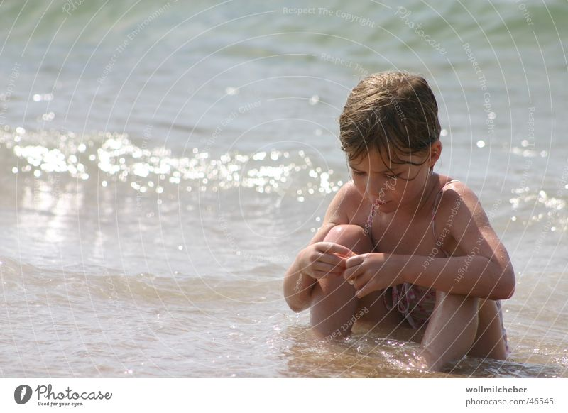 Child Water Girl Sun Ocean Beach Far-off places Playing Waves Concentrate Mussel Surf Dreamily Deepen Bright background