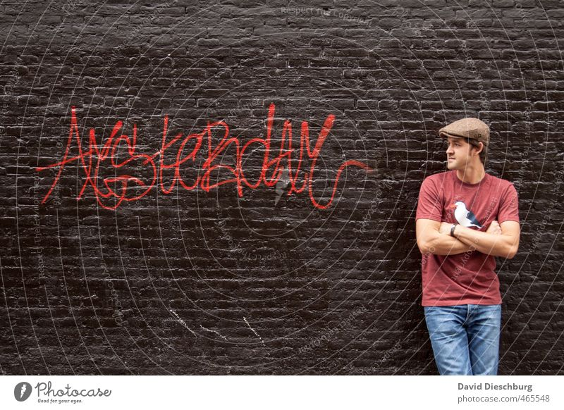 Human being Youth (Young adults) Man Vacation & Travel Blue City Red Black Young man Adults 18 - 30 years Graffiti Wall (building) Wall (barrier) Stone Brown