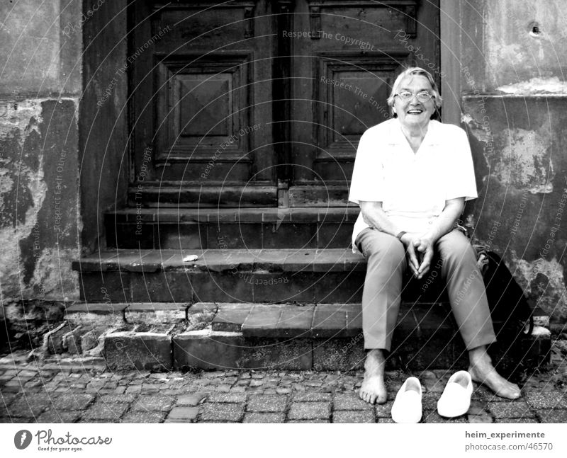 Woman Joy Calm Wall (building) Laughter Feet Footwear Hiking Door Stairs Break Grandmother Brave Ruin War Disaster