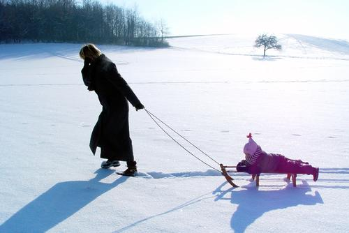family life Sleigh Sledding Snowscape Mother Child Leisure and hobbies Family & Relations Tracks Pure White Cold To go for a walk Winter Back-light Pull Shadow