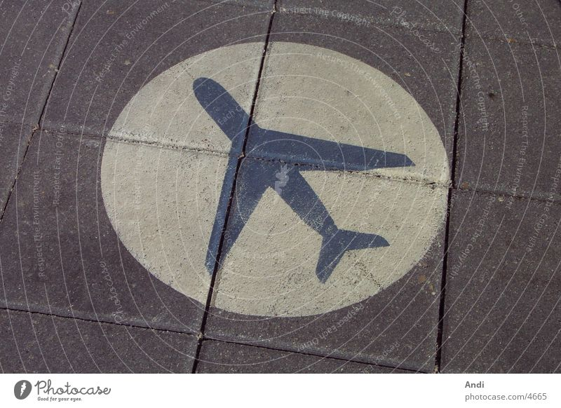 Airplane Signs and labeling Floor covering Road marking Icon Lettering Photographic technology
