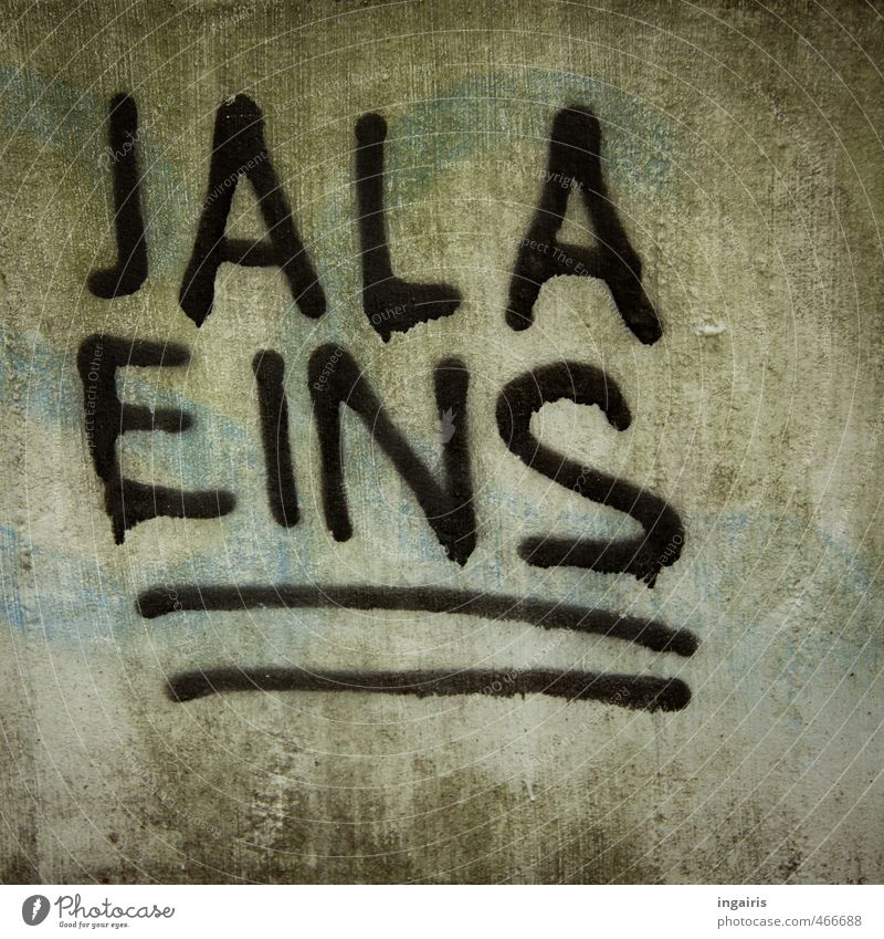 Hello, Jala! Outskirts Deserted Wall (barrier) Wall (building) Concrete Sign Digits and numbers Graffiti Line Discover Looking Uniqueness Town Gray Green Black
