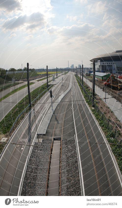 Sky Far-off places Railroad tracks Tram Mannheim Ice stadium Light railed vehicle