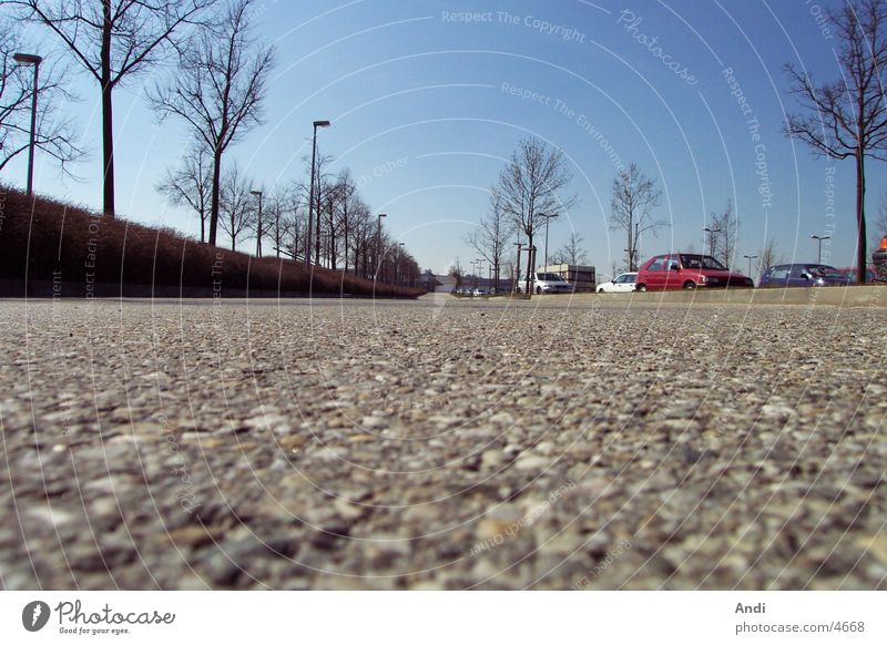 parking space Parking lot Photographic technology Car Floor covering Perspective