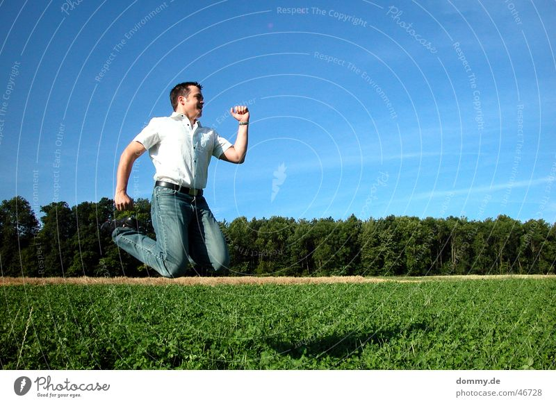 Man Sun Summer Joy Clouds Eyes Forest Meadow Boy (child) Jump Hair and hairstyles Warmth Field Nose Flying Physics