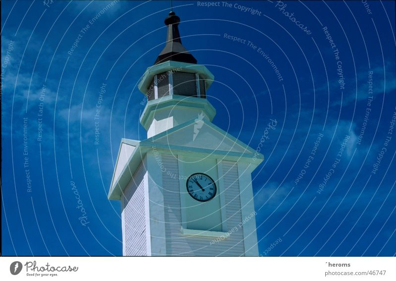 Clock Tower Sky Tower clock Spire Bright background Isolated Image Copy Space right Blue sky Architecture