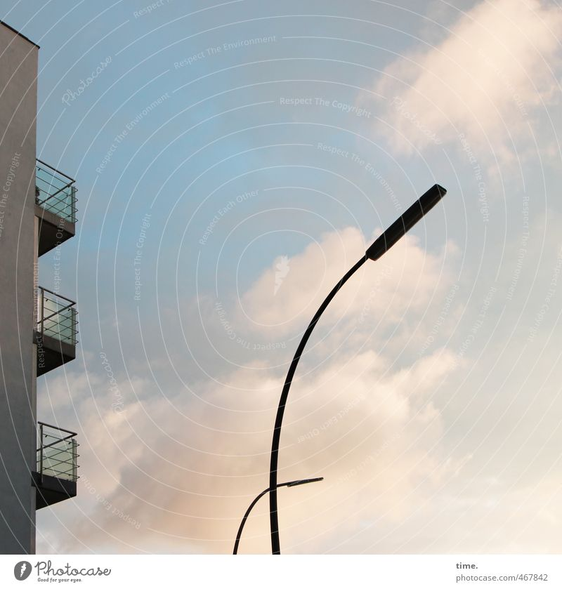 and in the evening with lighting ... Sky Clouds Beautiful weather High-rise Street lighting Lamp post Wall (barrier) Wall (building) Balcony Elegant Thin Town