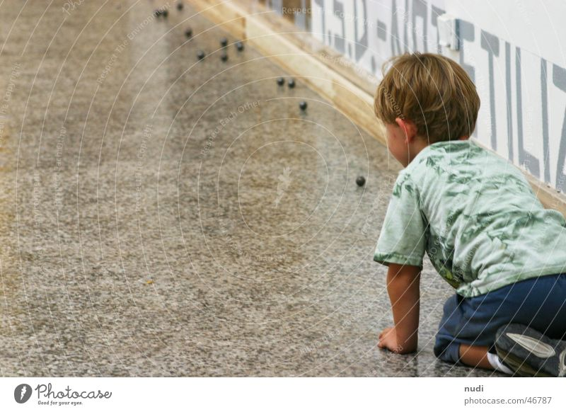 Fascination Sphere Child Boy (child) Playing T-shirt Blonde Wall (building) Venice Joy Floor covering on your knees art biennial boy play fun Rear view