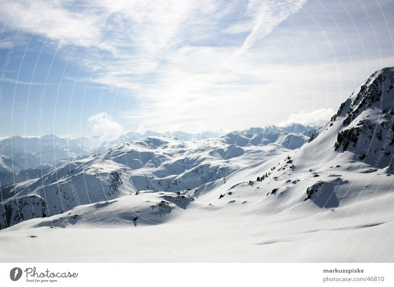 Far-off places Snow Mountain Alps Vantage point Snowscape Ski run Mountain range Snowcapped peak Alpine Ski resort Clouds in the sky Snow layer