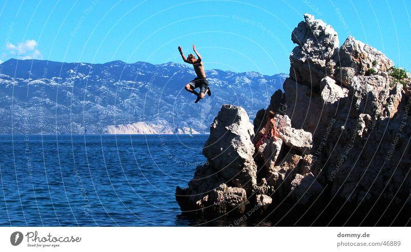 Man Hand Sun Ocean Blue Clouds Jump Stone Legs Flying Rock Dangerous Threat Croatia Adriatic Sea