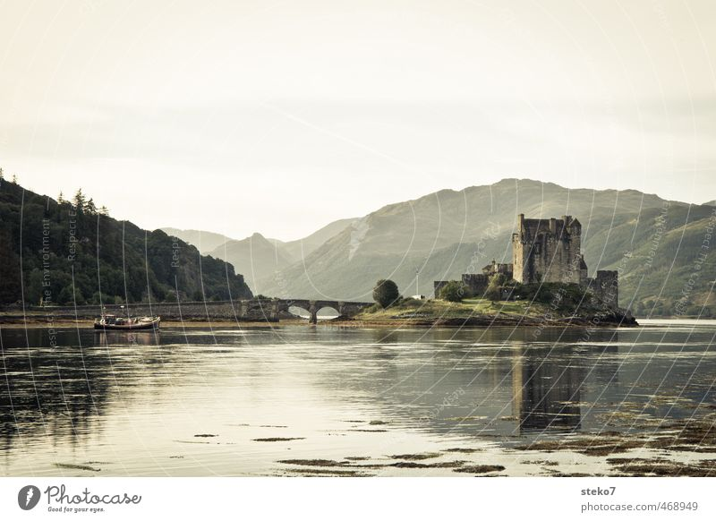 home delivery Mountain Lakeside Island Castle Bridge Fishing boat Brown Green Calm Scotland Eilean Donan castle Black & white photo Exterior shot Deserted