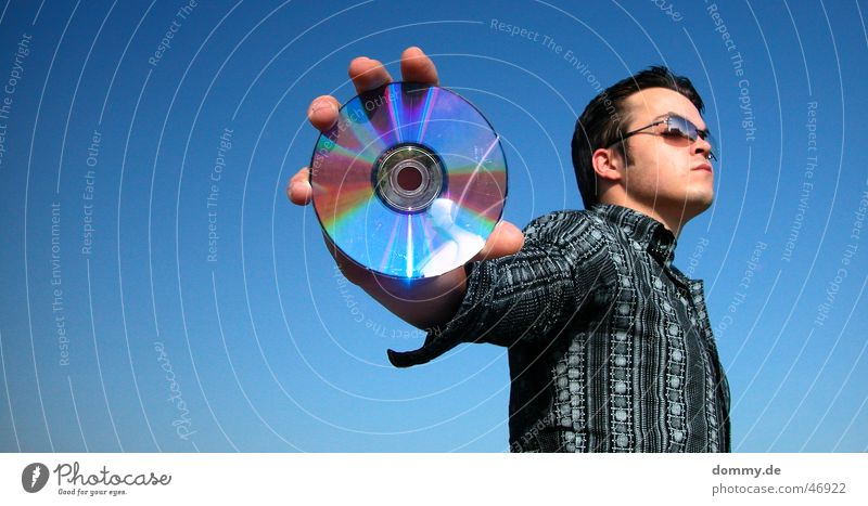 cdman Man Stand Eyeglasses Shirt Round Reflection Summer CD dommy Thomas Looking Data storage Music Silver Blue Sky Sun Open Advertising