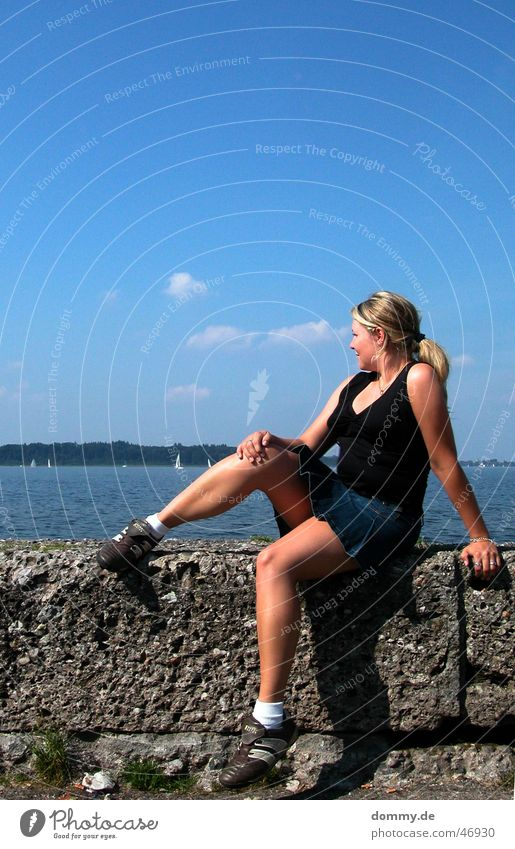 Woman Sun Summer Clouds Stone Wall (barrier) Lake Warmth Bavaria Sit Physics Mini skirt Lake Chiemsee