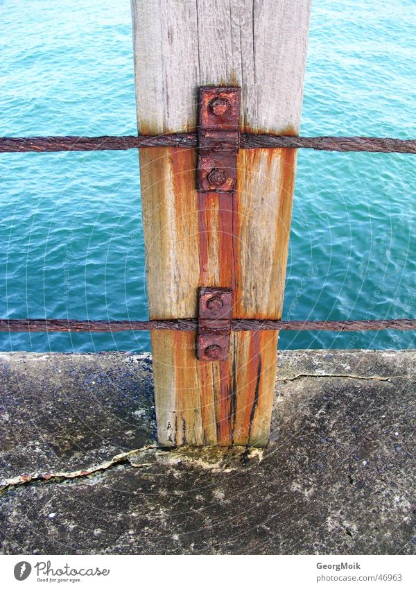 vapid Ocean Wood Iron Footbridge Whitby England Jetty Wood flour Rust Nail Red Water wry Stone sea timber way Old Beautiful Blue