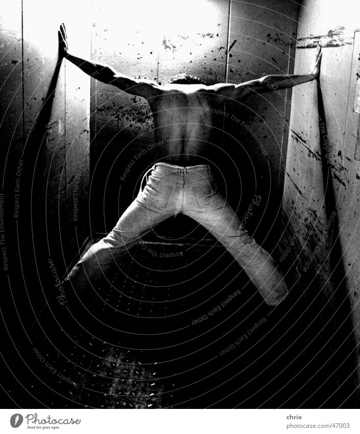 Human being Dark Wall (building) Legs Metal Bright Arm Back Pants Fight Elevator Musculature Barefoot Scratch mark Gray scale value