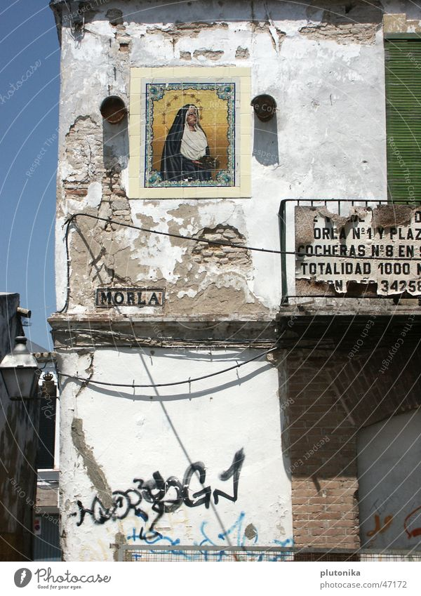 White Sun House (Residential Structure) Wall (barrier) Gold Signs and labeling Europe Derelict Brick Decline Balcony Cadiz Spain Plaster South Christianity