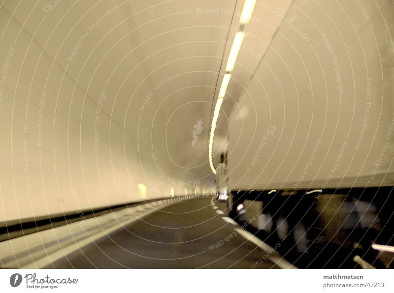 White Street Movement Bright Signs and labeling Speed Perspective Driving Logistics Truck Tunnel Deep Curve Followers Overtake