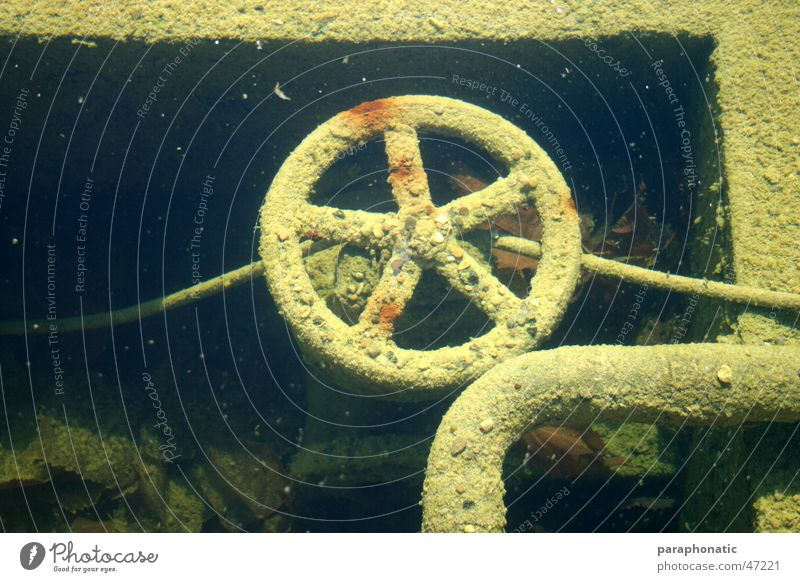 underwater wheel Wheel Crank Round Revolving Old Supply pipe Diversion Pebble Multicoloured Dirty Broken Exterior shot Second-hand Underwater photo in the water
