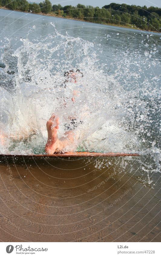 big splash Beach Tree Summer Action Sudden fall Waves Lake Water Drops of water Sand Sun Feet Human being Joy skiboard Movement Nature Wooden board