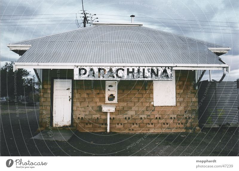 Parachilna railway station Railroad Railroad tracks Outback Australia Derelict Clouds Brick Electricity pylon Letters (alphabet) Train station Hut Old