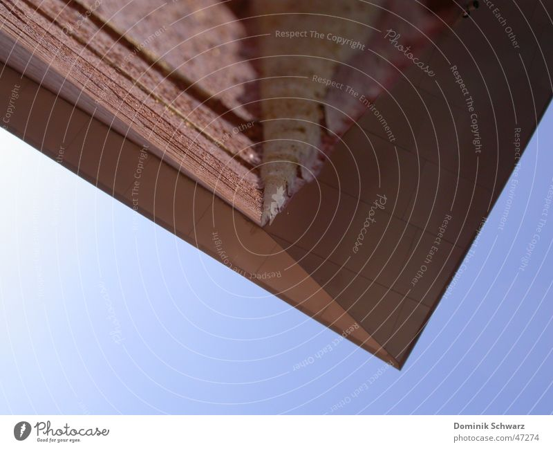 down under Wall (barrier) Brick Red Roof Canopy Under Inverted Building Perspective Sky Blue projection Above sore stonewalled built Architecture