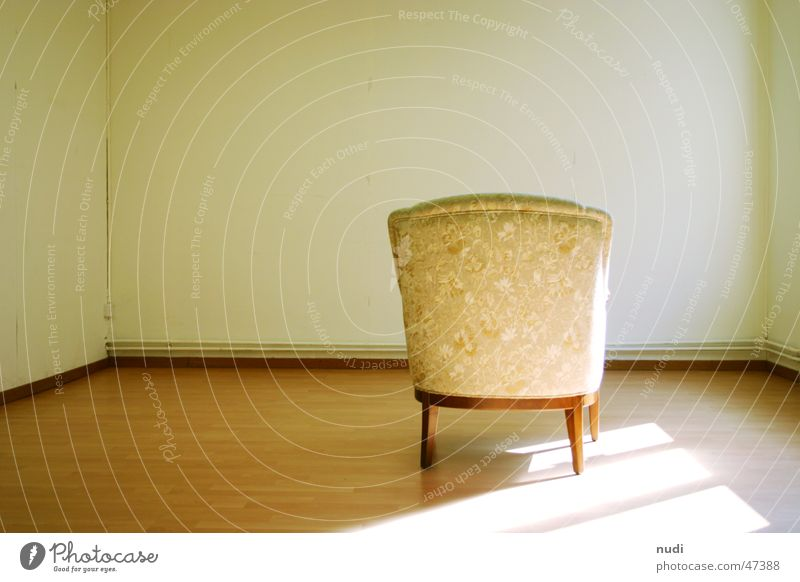 Loneliness Wall (building) Room Chair Floor covering Armchair Hall