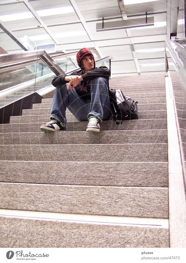 absorbed in thought Style School building Man Adults Youth (Young adults) Train station Airport Escalator Think Sit Dream Wait Loneliness Target Thought Aimless
