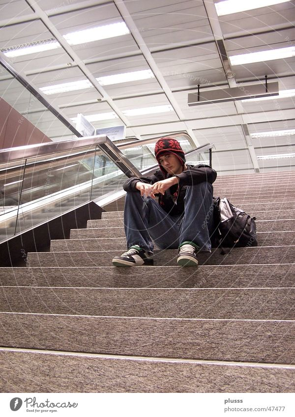 In the Thought2 Style Human being Man Adults Youth (Young adults) Airport Stairs Escalator Cap Sit Dream Wait Loneliness Solitary Empty Baseball cap Go under