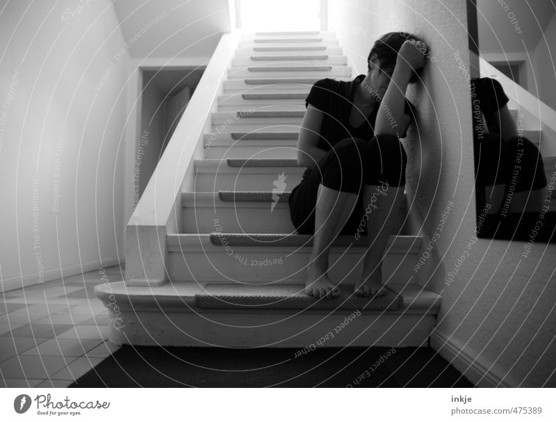 Sad woman sits on stairs Lifestyle Living or residing Flat (apartment) Staircase (Hallway) Stairs Woman Adults Body 1 Human being 30 - 45 years Crouch Sit